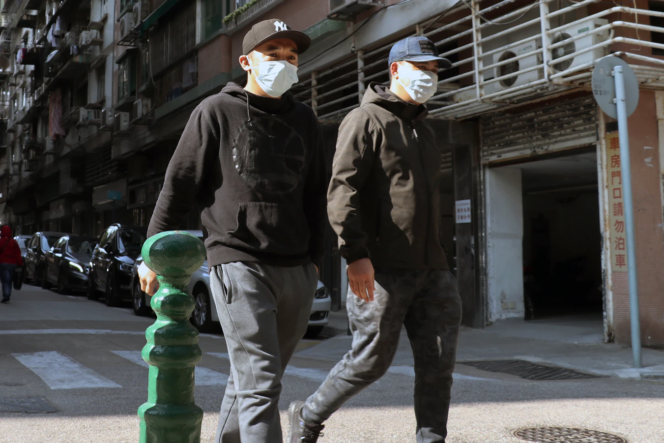 Two people wearing surgical masks